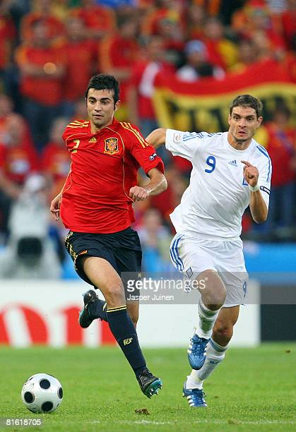 Raul Albiol of Spain is chased by Angelos Charisteas of Greece during the UEFA EURO 2008 Group D match between Greece and Spain at Stadion...