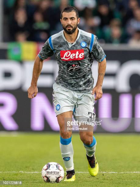 Raul Albiol of SSC Napoli runs with the ball during the Pre Season friendly match between VfL Wolfsburg and SSC Napoli at Volkswagen Arena on August...