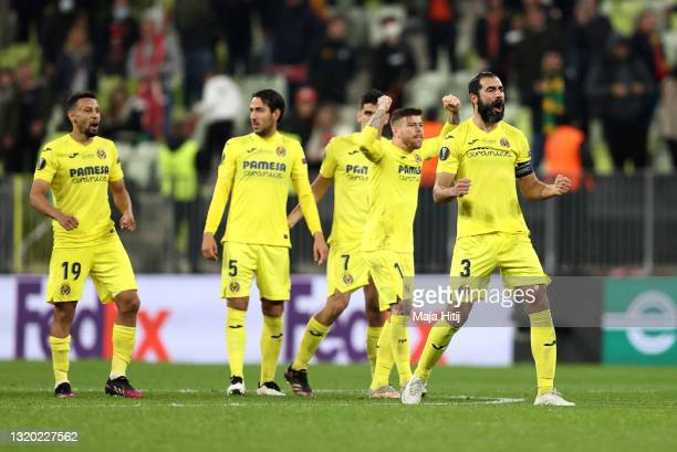 Raul Albiol of Villarreal and teammates celebrate during the penalty shoot out during the UEFA Europa League Final between Villarreal CF and...