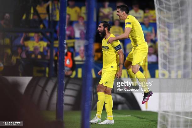 Raul Albiol of Villarreal celebrates with teammate Gerard Moreno after scoring their team's second goal during the UEFA Europa League Semi-final...