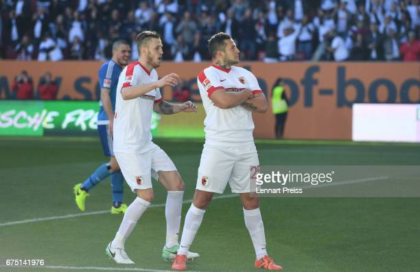 Raul Bobadilla and Jeffrey Gouweleeuw of FC Augsburg celebrate scoring their side's fourth goal during the Bundesliga match between FC Augsburg and...