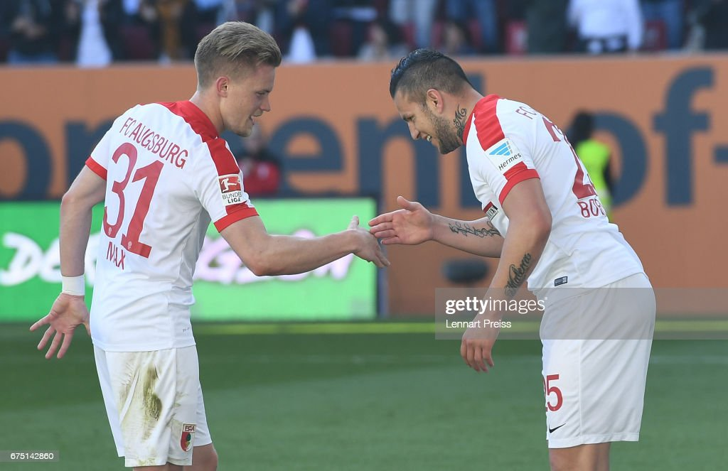 Raul Bobadilla (R) and Philipp Max of FC Augsburg celebrate scoring their side's fourth goal during the Bundesliga match between FC Augsburg and Hamburger SV at WWK Arena on April 30, 2017 in Augsburg, Germany.