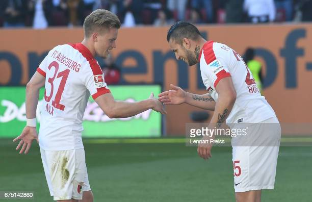 Raul Bobadilla and Philipp Max of FC Augsburg celebrate scoring their side's fourth goal during the Bundesliga match between FC Augsburg and...