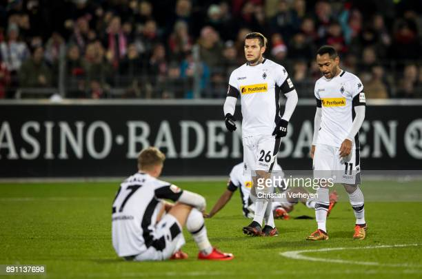 Raul Bobadilla and Raffael looks dejected after the Bundesliga match between SC Freiburg and Borussia Moenchengladbach at SchwarzwaldStadion on...