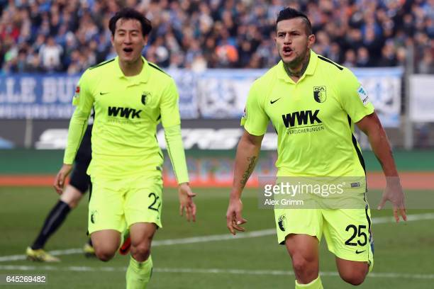 Raul Bobadilla of Augsburg celebrates his team's second goal with team mate DongWon Ji during the Bundesliga match between SV Darmstadt 98 and FC...