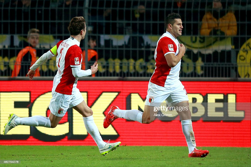 Raul Bobadilla of Augsburg celebrates scoring the opening goal with his team mate Paul Verhaegh (L) during the Bundesliga match between Borussia Dortmund and FC Augsburg at Signal Iduna Park on February 4, 2015 in Dortmund, Germany.