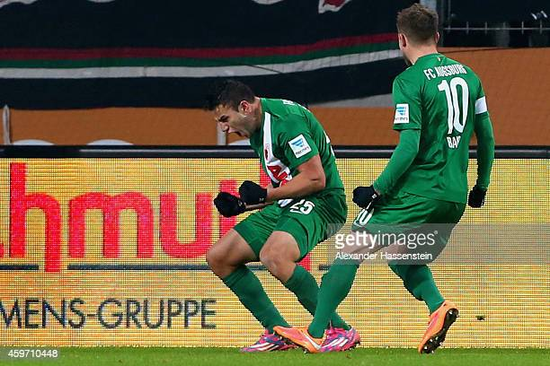 Raul Bobadilla of Augsburg celebrates scoring the second team goal with his team mate Daniel Baier during the Bundesliga match between FC Augsburg...