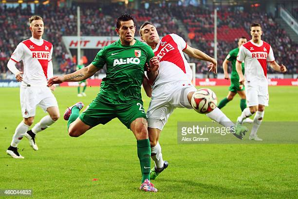 Raul Bobadilla of Augsburg is challenged by Jonas Hector of Koeln during the Bundesliga match between 1 FC Koeln and FC Augsburg at...
