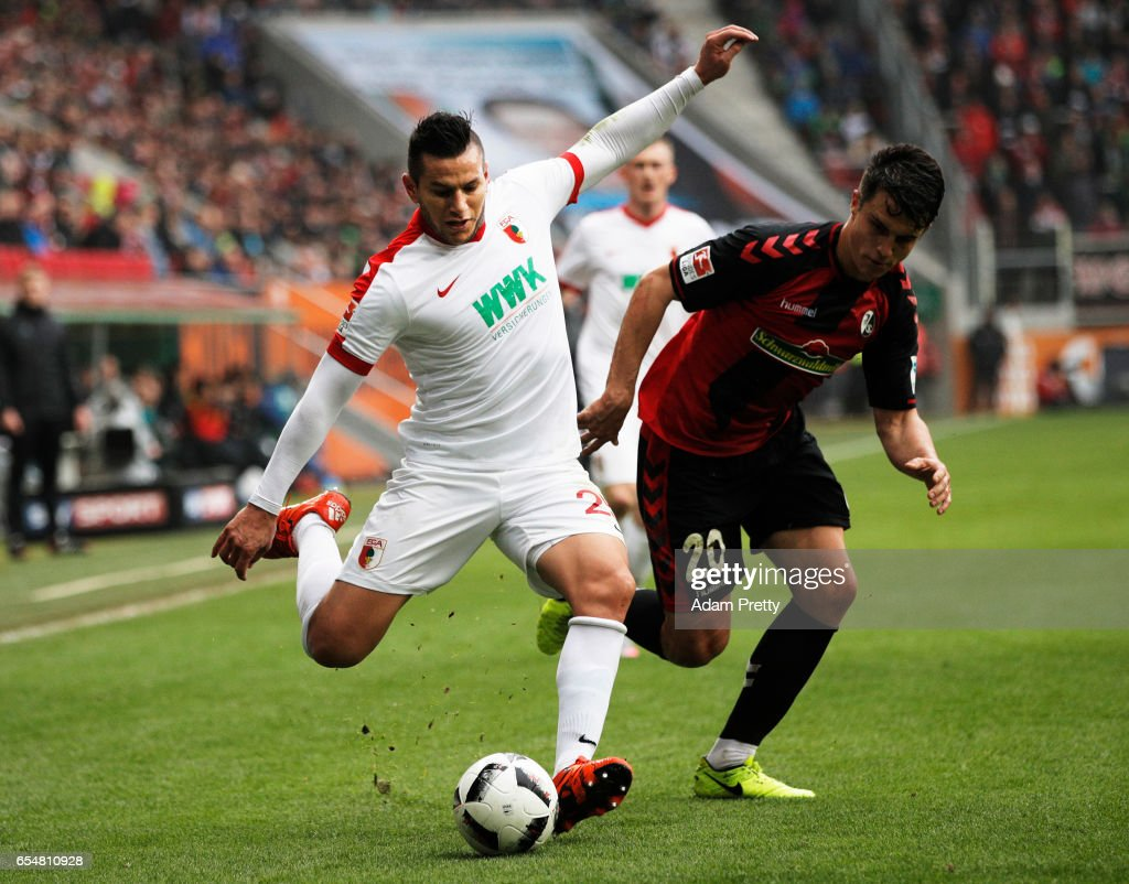Raul Bobadilla of Augsburg is challenged by Marc-Oliver Kempf of Freiburg during the Bundesliga match between FC Augsburg and SC Freiburg at WWK Arena on March 18, 2017 in Augsburg, Germany.