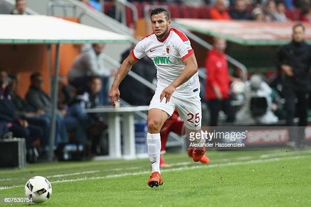 Raul Bobadilla of Augsburg runs with the ball during the Bundesliga match between FC Augsburg and 1 FSV Mainz 05 at WWK Arena on September 18 2016 in...