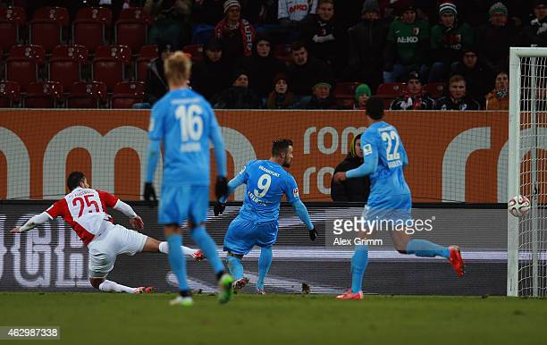 Raul Bobadilla of Augsburg scores his team's second goal during the Bundesliga match between FC Augsburg and Eintracht Frankfurt at SGL Arena on...