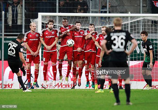 Raul Bobadilla of Augsburg scores the first goal during the Bundesliga match between FC Ingolstadt 04 and FC Augsburg at Audi Sportpark on November 5...
