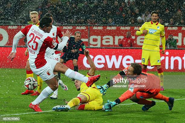 Raul Bobadilla of Augsburg tries to score against Goalkeeper Oliver Baumann and Ermin Bicakcic of Hoffenheim during the Bundesliga match between FC...