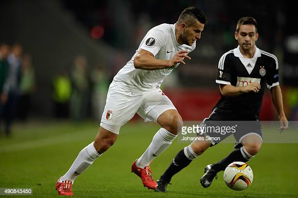 Raul Bobadilla of Augsburg vies with Andrija Zivkovic of Partizan during the UEFA Europa League group L football match FC Ausburg vs FK Partizan at...