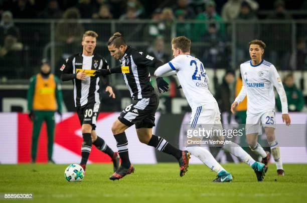 Raul Bobadilla of Borussia Moenchengladbach and Bastian Ocipka of FC Schalke 04 battle for the ball during the Bundesliga match between Borussia...