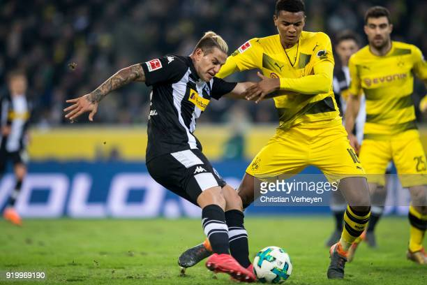 Raul Bobadilla of Borussia Moenchengladbach and Manuel Akanji of Borussia Dortmund battle for the ball during the Bundesliga match between Borussia...