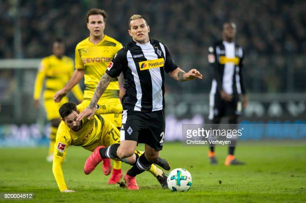 Raul Bobadilla of Borussia Moenchengladbach is chased by Gonzalo Castro of Borussia Dortmund during the Bundesliga match between Borussia...