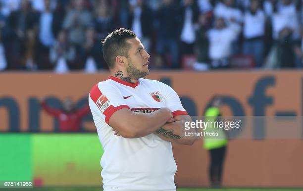 Raul Bobadilla of FC Augsburg celebrates scoring his side's fourth goal during the Bundesliga match between FC Augsburg and Hamburger SV at WWK Arena...