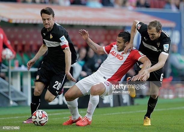 Raul Bobadilla of FC Augsburg is challenged by Christian Gentner and Georg Niedermeier of VfB Stuttgart during the Bundesliga match between FC...