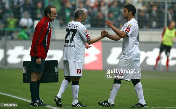 Raul Bobadilla of Gladbach is replaced by Oliver Neuville during the Bundesliga match between Borussia Moenchengladbach and Bayer Leverkusen at...