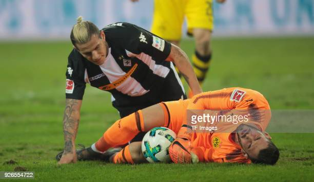 Raul Bobadilla of Moenchengladbach and Goalkeeper Roman Buerki of Dortmund on the ground during the Bundesliga match between Borussia...