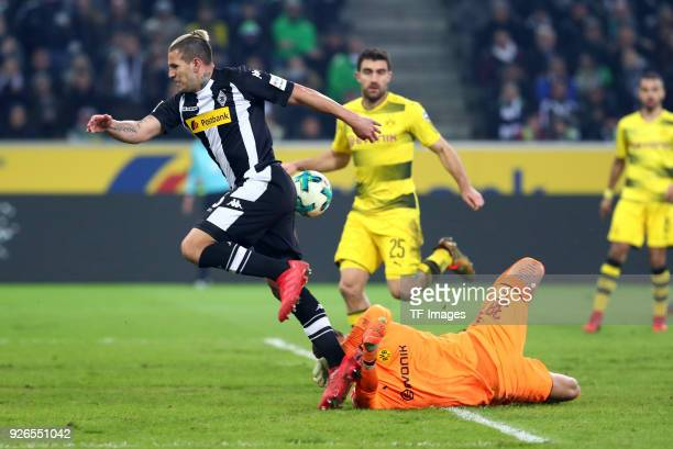 Raul Bobadilla of Moenchengladbach and Goalkeeper Roman Buerki of Dortmund battle for the ball during the Bundesliga match between Borussia...