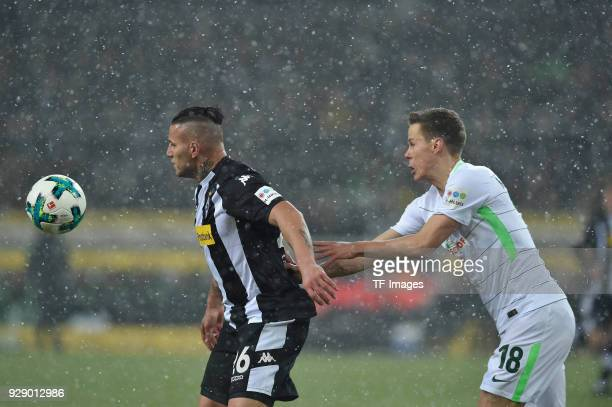 Raul Bobadilla of Moenchengladbach and Niklas Moisander of Bremen battle for the ball during the Bundesliga match between Borussia Moenchengladbach...