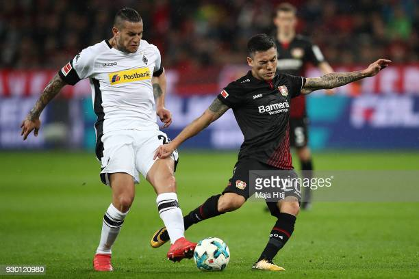 Raul Bobadilla of Moenchengladbach fights for the ball with Aranguiz of Bayer Leverkusen during the Bundesliga match between Bayer 04 Leverkusen and...