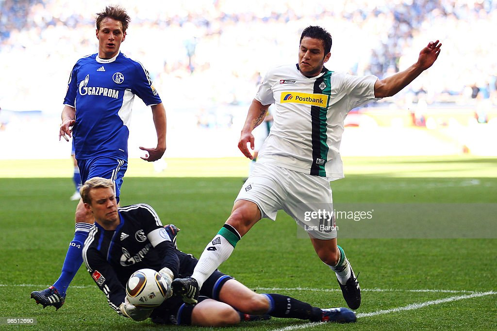 Raul Bobadilla of Moenchengladbach gets the ball before goalkeeper Manuel Neuer of Schalke and scores the second goal during the Bundesliga match between FC Schalke 04 and Borussia Moenchengladbach at Veltins Arena on April 17, 2010, in Gelsenkirchen, Germany.