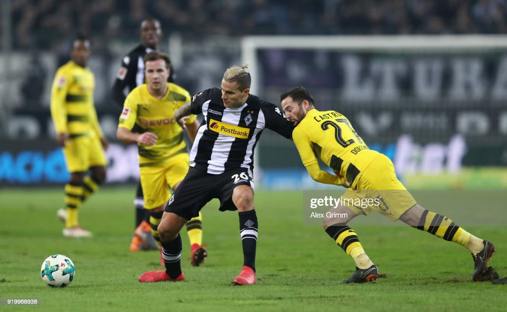 Raul Bobadilla of Moenchengladbach is held by Gonzalo Castro of Dortmund during the Bundesliga match between Borussia Moenchengladbach and Borussia Dortmund at Borussia-Park on February 18, 2018 in Moenchengladbach, Germany.