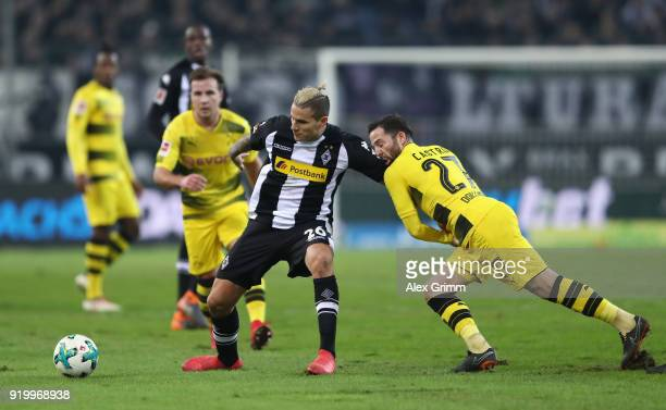 Raul Bobadilla of Moenchengladbach is held by Gonzalo Castro of Dortmund during the Bundesliga match between Borussia Moenchengladbach and Borussia...