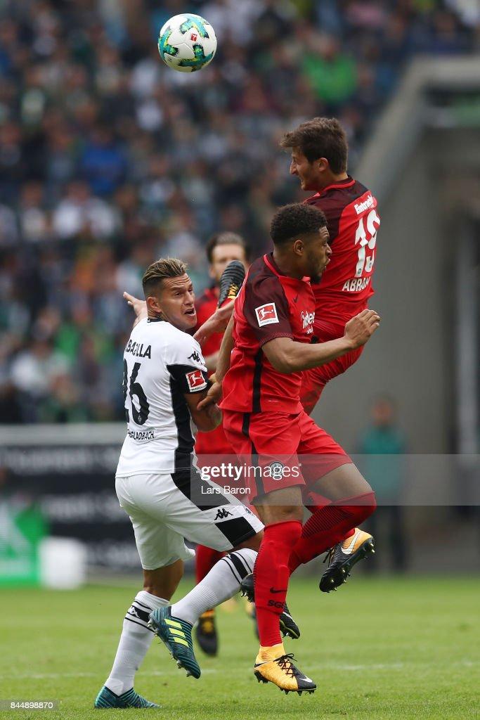 Raul Bobadilla of Moenchengladbach (l), Simon Falette of Frankfurt (c) and David Abraham of Frankfurt fight for the ball during the Bundesliga match between Borussia Moenchengladbach and Eintracht Frankfurt at Borussia-Park on September 9, 2017 in Moenchengladbach, Germany.