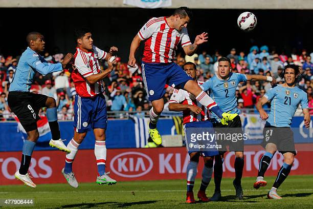 Raul Bobadilla of Paraguay heads the ball during the 2015 Copa America Chile Group B match between Uruguay and Paraguay at La Portada Stadium on June...