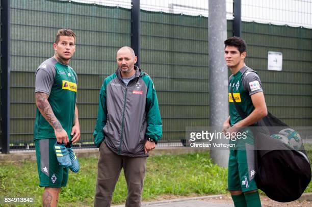 Raul Bobadilla talks to Oliver Neuville and Julio Villalba during the training session of Borussia Moenchengladbach at BorussiaPark on August 18 2017...