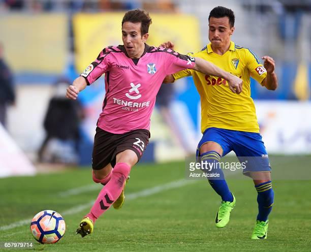 Raul Camara of CD Tenerife being followed by Alvaro Garcia of Cadiz CF during La Liga Segunda Division between Cadiz CF and CD Tenerife at Estacio...