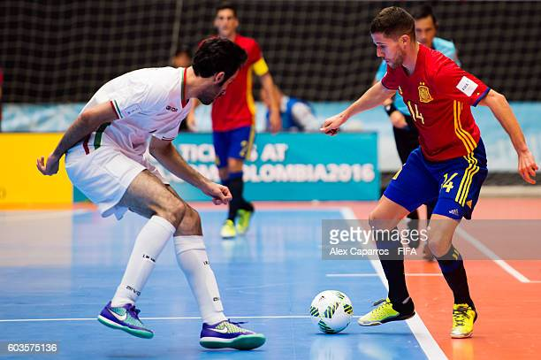 Raul Campos of Spain challenges Ahmad Esmaeilpour of Iran during the FIFA Futsal World Cup Group F match between Iran and Spain at Coliseo Ivan de...