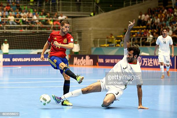 Raul Campos of Spain has his shot at goal blocked by Ahmad Esmaeilpour of Iran during the FIFA Futsal World Cup Group F match between Iran and Spain...