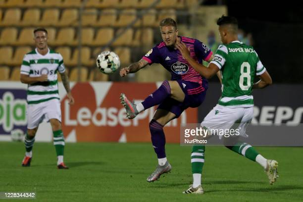 Raul Carnero of Real Valladolid CF vies with Matheus Nunes of Sporting CP during the pre season friendly football match between Sporting CP and Real...