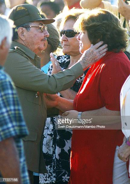 Raul Castro Cuba's acting President greets daughter of Che Guevara Aleida Guevara next to Che Guevara's widow Aleida March during a commemoration of...