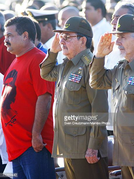 Raul Castro Cuba's acting President salutes during the national anthem during a commemoration of the 40th anniversary of the death of Ernesto Che...