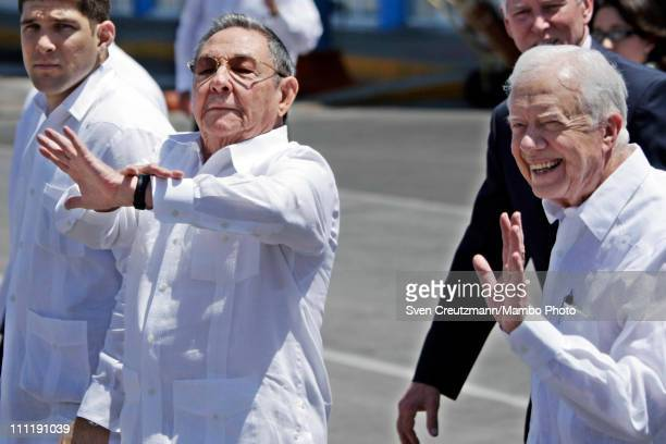 Raul Castro President of Cuba leads former US President Jimmy Carter to the airplane for Carter's departure at the Jose Marti airport on March 30...