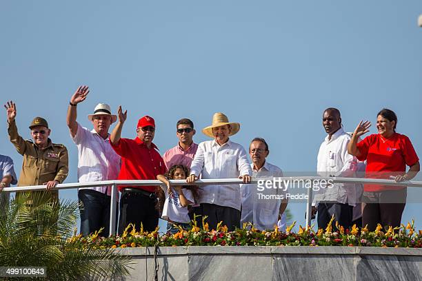Raul Castro smiles to the crowds at the foot of the José Marti tower. Taken in Havana, Cuba on May Day, 2014.