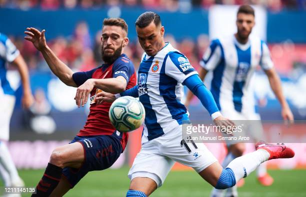 Raul de Tomas Gomez of RCD Espanyol duels for the ball with Roberto Torres of CA Osasuna during the Liga match between CA Osasuna and RCD Espanyol at...