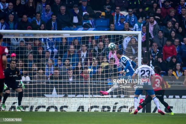 Raul de Tomas of Espanyol heads the winning goal beating goalkeeper Manolo Reina of Mallorca during the Espanyol V Mallorca La Liga regular season...