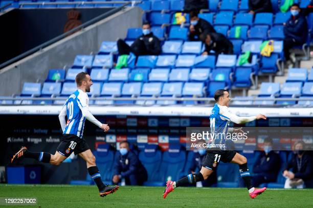 Raul de Tomas of RCD Espanyol celebrates with his teammate Sergi Darder after scoring the opening goal during the LaLiga SmartBank match between RCD...