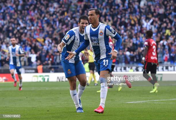 Raul de Tomas of RCD Espanyol celebrates with Jonathan Calleri after scoring his team's first goal during the La Liga match between RCD Espanyol and...
