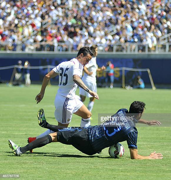 Raul De Tomas of Real Madrid fights for the ball as Andrea Ranocchia of Inter Milan falls during an International Champions Cup match in Berkeley...