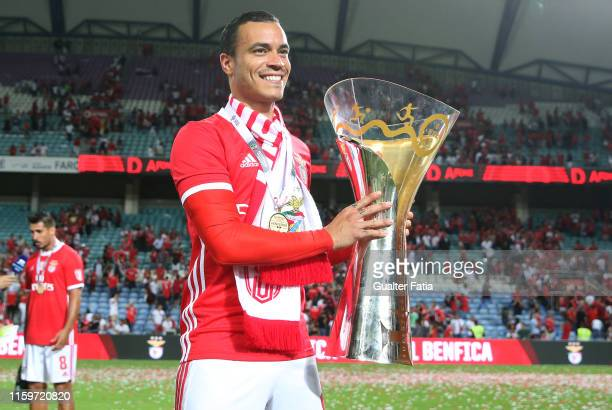 Raul de Tomas of SL Benfica celebrates with trophy after winning the Portuguese SuperCup at the end of the Portuguese SuperCup match between SL...