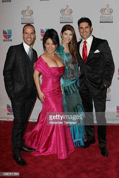 Raul Garcia Carolina Sandoval guest and Rodolfo Jimenez arrive at Univision's Premio Lo Nuestro a La Musica Latina Awards at AmericanAirlines Arena...