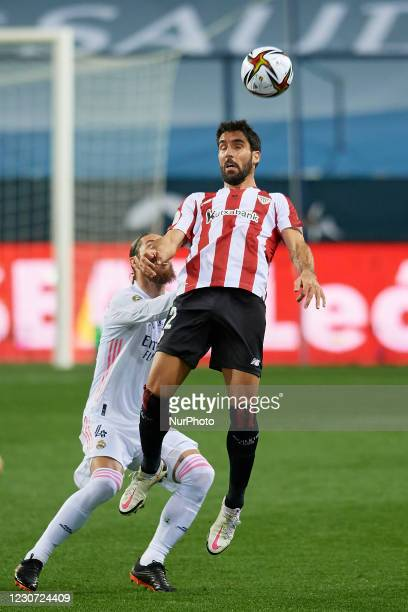 Raul Garcia of Athletic and Sergio Ramos of Real Madrid compete for the ball during the Supercopa de Espana Semi Final match between Real Madrid and...